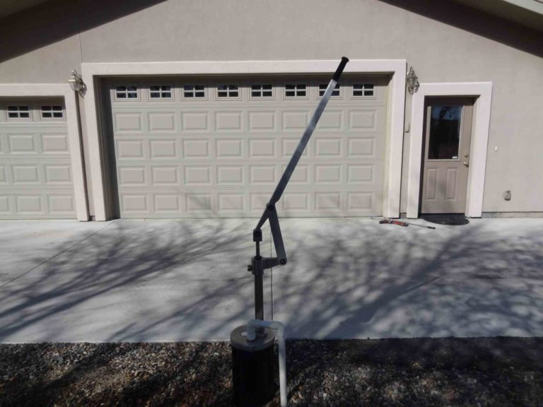 Simple Pump Customer Installation Deep Well Hand Pump next to Garage